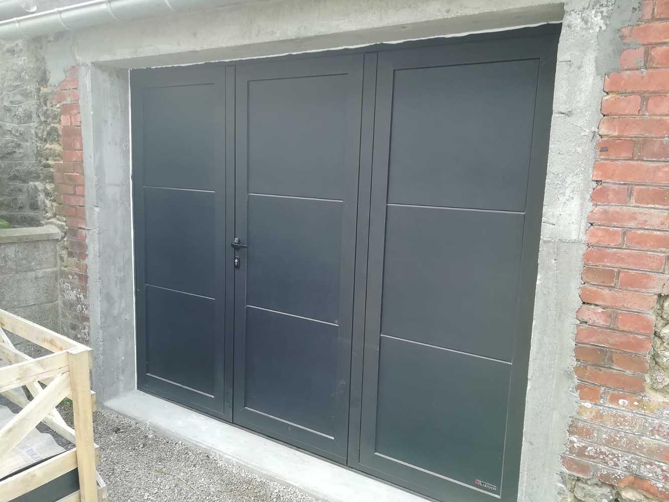 Porte de garage 3 battants - alu gris 0